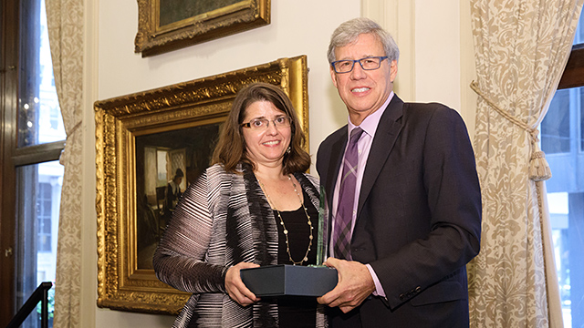 University of Chicago Professor Geoffrey Stone (right) presented Professor Carolyn Shapiro with a 2017 Abner Mikva Award from the Chicago Lawyer Chapter of the American Constitution Society at a luncheon at the Union League Club. (Photo by Andrew Collings.)