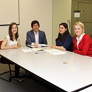 Professor Ed Lee meets with 1L IP Fellows, from left, Erika Rodger, Raven Zeer and Margot Wilson.