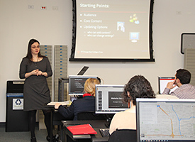 Technology development and training librarian Emily Barney advises SSPI participants on building websites.