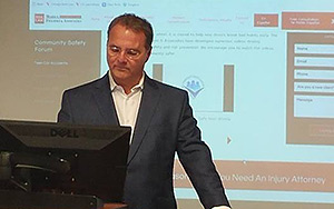 James J. Morici, Jr. ('79) showing participants written and video content in a firm website.