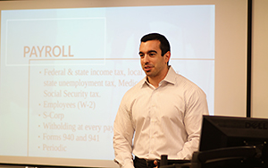 Andrew Gordon ('12) discusses accounting and tax basics to participants.