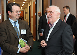 Chicago-Kent professor and Illinois solicitor general Michael Scodro (left) chats with Justice Stevens after the luncheon.
