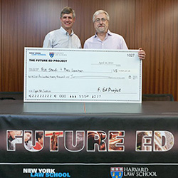 "Chicago-Kent Professor Ronald Staudt (left) and Marc Lauritsen, founder and president of Capstone Practice Systems, accepted a check for ""simulated venture dollars,"" which they hope will soon lead to real funding, for their winning Apps for Justice concept from the 2011 Future Ed competition."