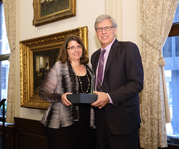 University of Chicago Professor Geoffrey Stone (right) presented Professor Carolyn Shapiro with a 2017 Abner Mikva Award from the Chicago Lawyer Chapter of the American Constitution Society at a luncheon at the Union League Club. <em>(Photo by Andrew Collings.)</em>