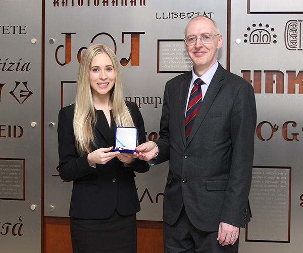 Professor Adrian Walters (right) presents Stephanie Wolf '17 with an ABI Medal of Excellence.