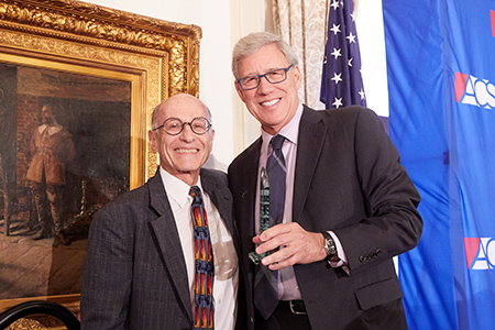 Distinguished Professor Sheldon Nahmod (left) accepts a 2018 Abner J. Mikva Award, presented by University of Chicago law professor Geoffrey Stone, co-chair of the American Constitution Society Chicago Lawyer Chapter Board of Advisors.