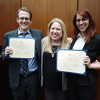 Evan Kline-Wedeen '18 and Brittany Kaplan '19, pictured here with their coach Ashly Boesche '04 (center), placed second overall and won the first-place best brief award at the 2018 Saul Lefkowitz Moot Court Competition's Midwest regional tournament. The team will advance to the national finals in March.