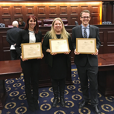 Brittany Kaplan '19 (left) and Evan Kline-Wedeen '18, pictured here with their coach Ashly Boesche '04 (center), won the 2018 Saul Lefkowitz Moot Court Competition, sponsored by the International Trademark Association.