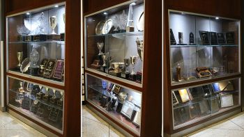 Glass cases with trophies from appellate advocacy competitions