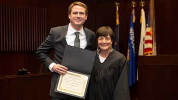 Illinois Appellate Judge Mary Mikva (right) presented Jack Etchingham '20 with the 2018 Ilana Diamond Rovner Award for Outstanding Appellate Advocate.