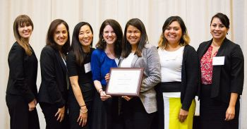 Members of the Immigration Law Society, pictured with Director of Institutional Projects Dawn Young (third from left), display their 2019 Outstanding Student Organization Award.
