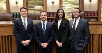 Kevin LaBarge '21 (left) and Micah Fishman '21 (second from left) will advance to the finals of the 2019 Thomas Tang National Moot Court Competition. Their teammates Michelle Locascio '21 (second from right) and Chris Tuinenga '21 (right) performed well in the regional tournament but didn't advance.